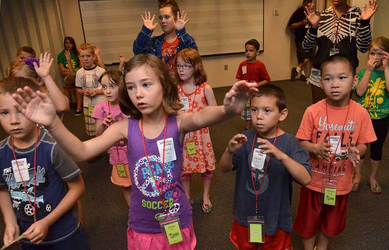 Photo Credit: REVIEW PHOTO: VERN UYETAKE - Children play during Vacation Bible School, held at Lake Bible Church, a park and Oak Creek Elementary School. The church is partnering with Child Evangelism Fellowship, a group aiming to spread its clubs into the Portland metro area.