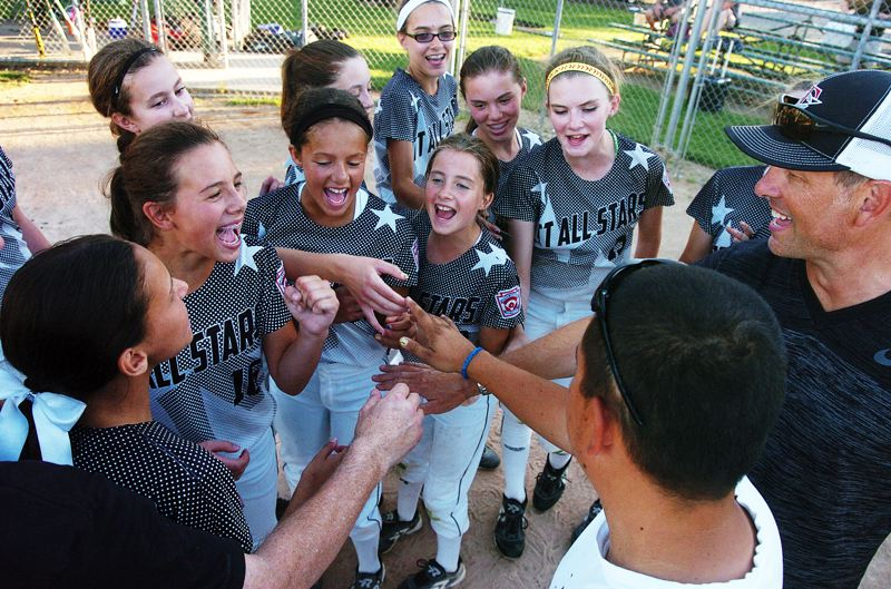 Photo Credit: DAN BROOD - BREAK -- The Tigard/Tualatin City Little League all-star softball team gathers at the end of practice on Tuesday. The team will open play at the Little League Softball World Series next Thursday.