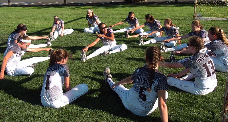 Photo Credit: DAN BROOD - STRETCHING OUT -- The Tigard/Tualatin City Little League softball team gets ready for practice.