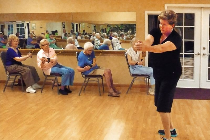 Photo Credit: PHOTO: JANIE L. NAFSINGER - Strength training is included in the fitness classes for seniors that Teena Hall teaches. Here, residents of Rose Villa retirement community in Milwaukie work with hand weights.