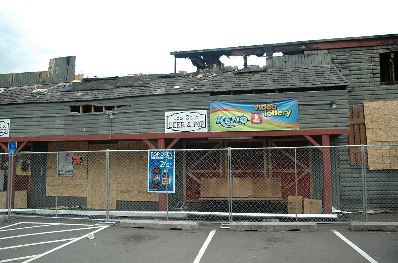 Photo Credit: ISABEL GAUTSCHI - Since the June 14 fire, the popular Estacada eatery Bailey's Pub & Grub and Currinsville Store have been boarded up.
