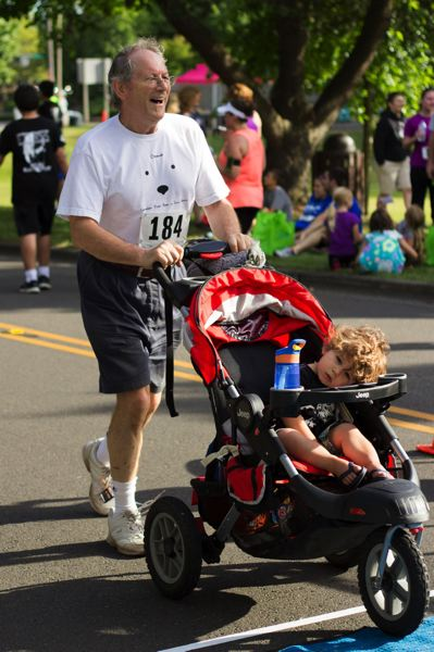 Photo Credit: TIMES PHOTO: LACEY JACOBY - Peter Letts finishes the 5K race with his son during the Sun Run in Beaverton.