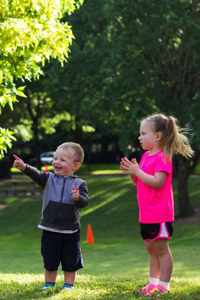 Photo Credit: TIMES PHOTO: LACEY JACOBY - Jameson Flynn, 1, and Beverly Flynn, 4, cheer on runners.