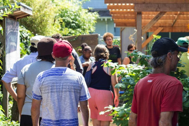 Photo Credit: TRIBUNE PHOTO: LACEY JACOBY - Visitors to Emerson Garden enjoy barbecue chicken, watermelon and other snacks as part of the Dirty Little Secrets bus tour last weekend; more tours may be offered as the proposed superfund plan approaches.