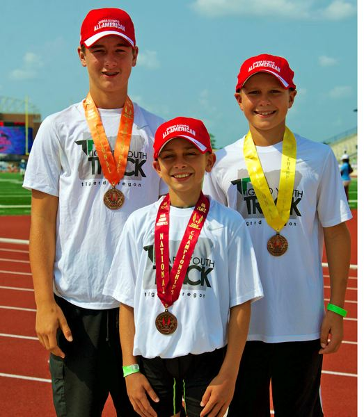 Photo Credit: SUBMITTED PHOTO - TRIPLE THREAT -- Tigard Youth Track Club's Spencer Smith, Spencer Kuffel and Koby Kessler all earned All-American honors.