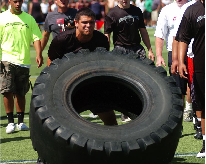 Photo Credit: DAN BROOD - FLIP IT -- Tualatin High School senior-to-be Cam Frey took first place in the tire flip event with 17 flips.