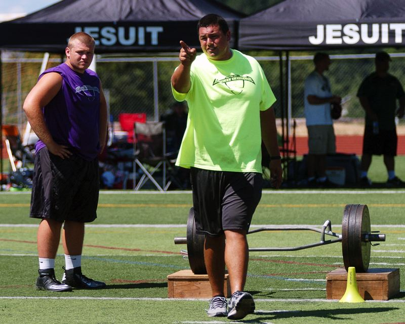 Photo Credit: DAN BROOD - IN CHARGE -- Ian Reynoso, founder of the Metro Area Lineman Challenge, gives directions prior to the farmer's carry event.