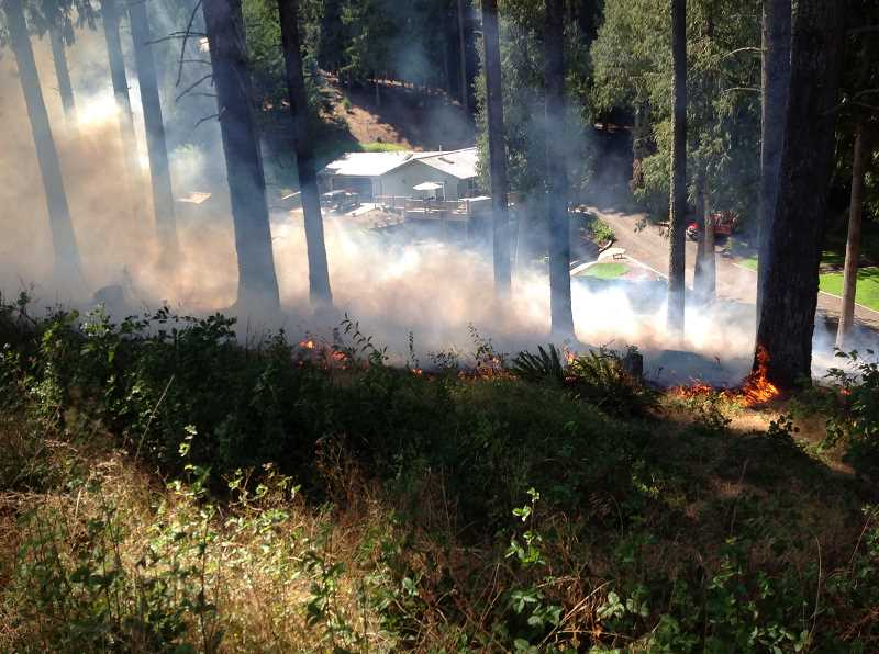 Photo Credit: COURTESY PHOTO - A Cornelius brush fire that threatened a home Thursday afternoon was quickly contained by local firefighters.
