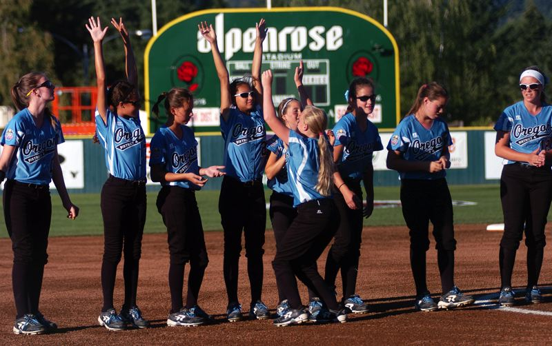 Photo Credit: DAN BROOD - HERE WE GO -- The Tigard/Tualatin City team shows its enthusiasm during the pregame introductions prior to Friday's Little League Softball World Series game.