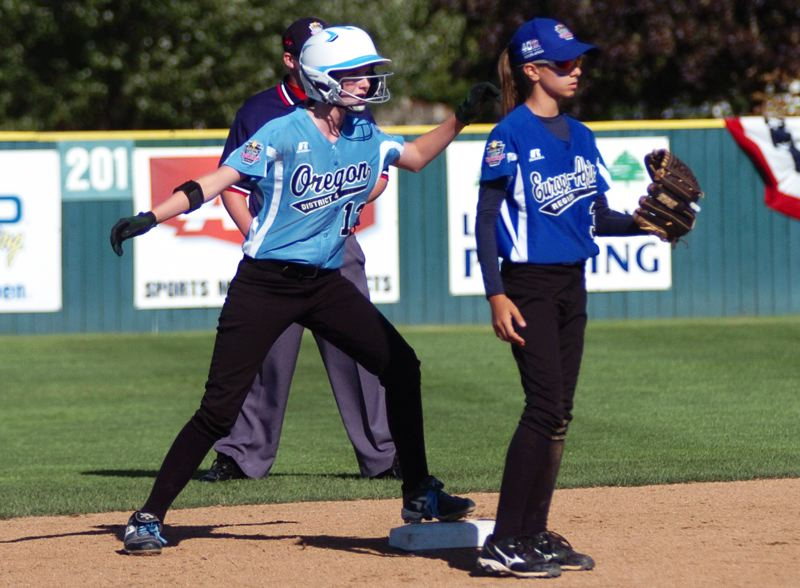 Photo Credit: DAN BROOD - ON THE BASE -- Tigard/Tualatin City's Jessica Redfern (left) gets to second base in the fourth inning of Saturday's game at the Little League Softball World Series.