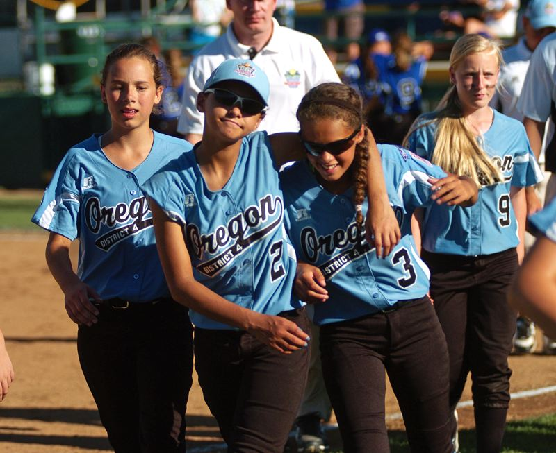 Photo Credit: DAN BROOD - WE WIN -- Tigard/Tualatin City's (from left) Carly Atwood, Kendra Zuckerman, Tia Cordts and Nicole Box walk off the field following the victory over Prague.