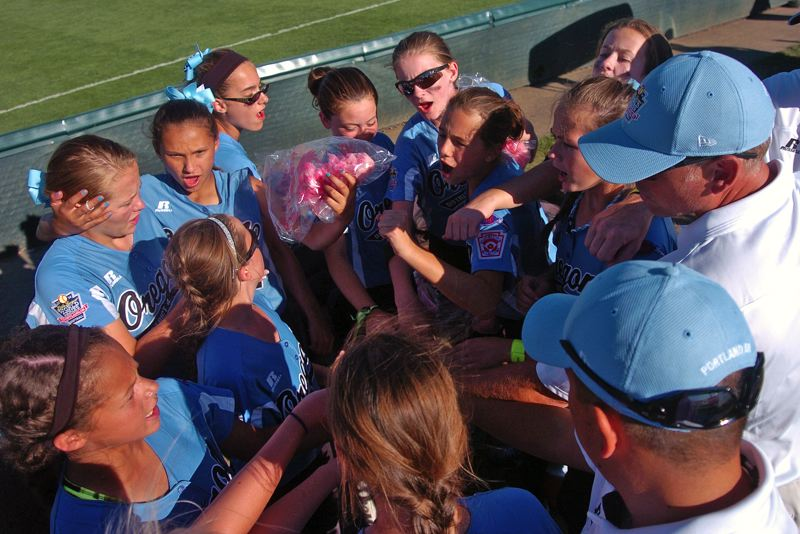Photo Credit: DAN BROOD - ALL TOGETHER -- Tigard/Tualatin City players and coaches gather following their 7-5 win over Prague Saturday at the Little League Softball World Series.