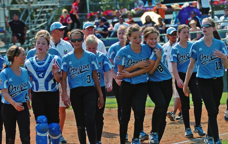 Photo Credit: DAN BROOD - ALL TOGETHER -- The Tigard/Tualatin City team walks off the field following the 2-1 victory over Puerto Rico Sunday at the Little League Softball World Series.