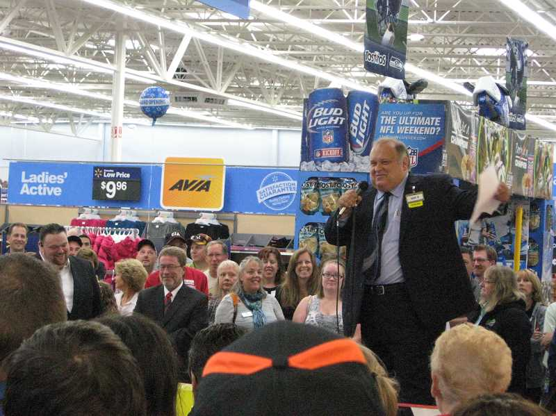 Photo Credit: GAZETTE PHOTO - Scot Gavic, store manager of the Sherwood Walmart Supercenter, leads Wednesday morning's opening ceremonies at the new store.
