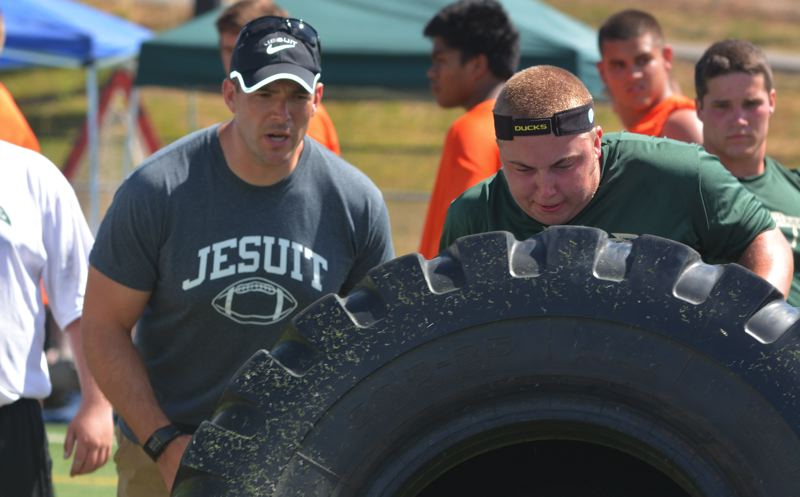Photo Credit: TIMES PHOTO: MATT SINGLEDECKER - Jesuit offensive line coach John Andreas played four seasons for the Crusaders during the early 90s and has a strong relationship with head coach Ken Potter.