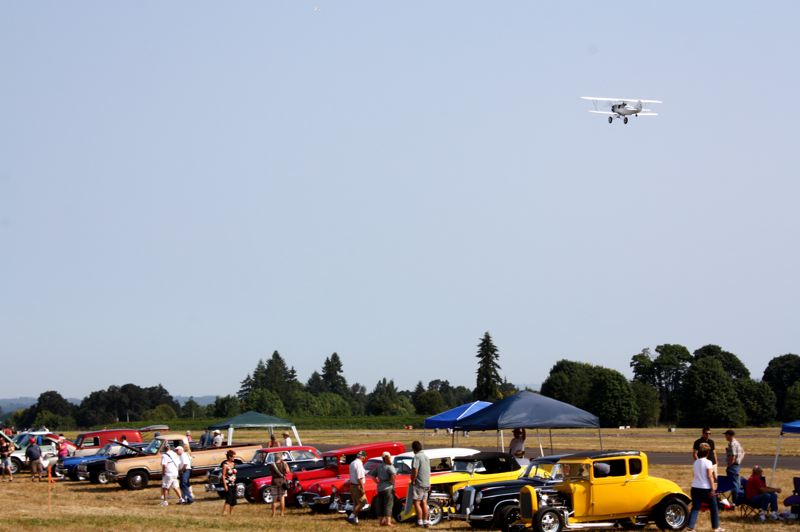 Photo Credit: FILE - A biplane takes off from Scappoose Industrial Airpark at a previous Wings & Wheels event. The South Columbia County Chamber of Commerce is putting on the event, which is sponsored by Oregon Aero, for its fourth year Saturday, Aug. 23.