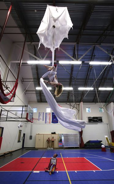 Photo Credit: TIMES PHOTO: JONATHAN HOUSE - Lisbeth Mikoleit emerges from a cocoon during her piece for 'High Art.'