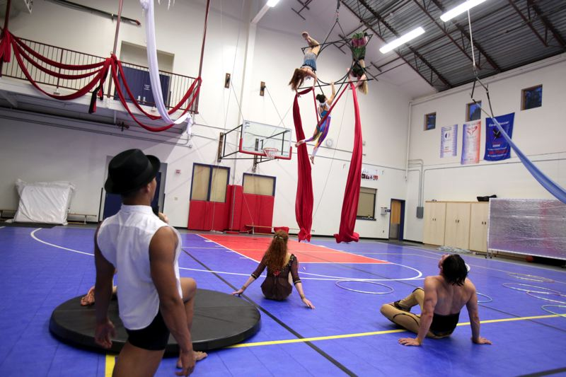 Photo Credit: TIMES PHOTO: JONATHAN HOUSE - The cast of 'High Art' practices at the French-American School of Portland, where Pendulum Aerial Arts is based.