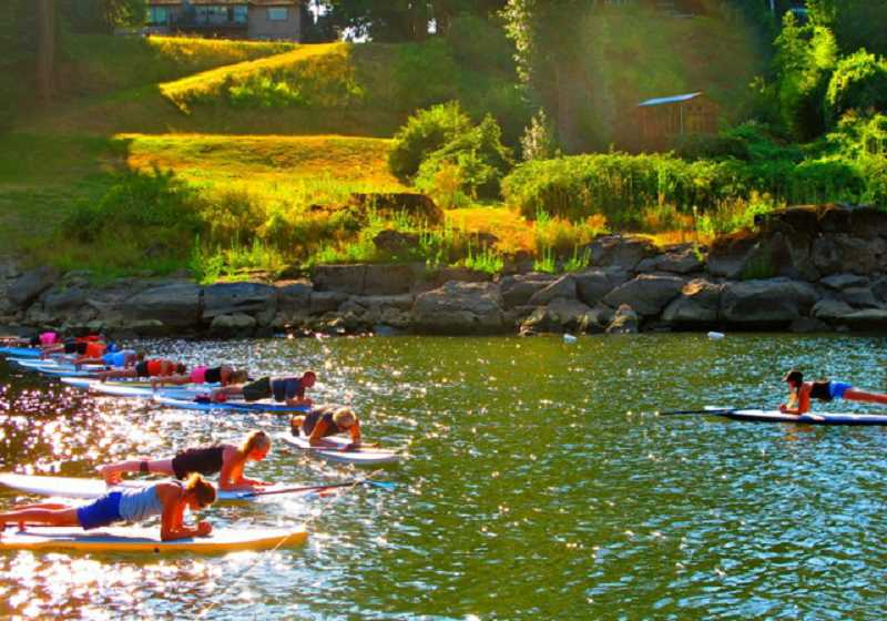 Photo Credit: SUBMITTED PHOTO - Laura Campbell, owner of Imagine Yoga Studio in West Linn, recently offered a unique experience - a stand up paddle yoga workshop. The class began with a brief yoga warm up followed by a mellow paddle, and ended with an hour long yoga class on a floating mat. To learn more visit imagineyogastudio.com.