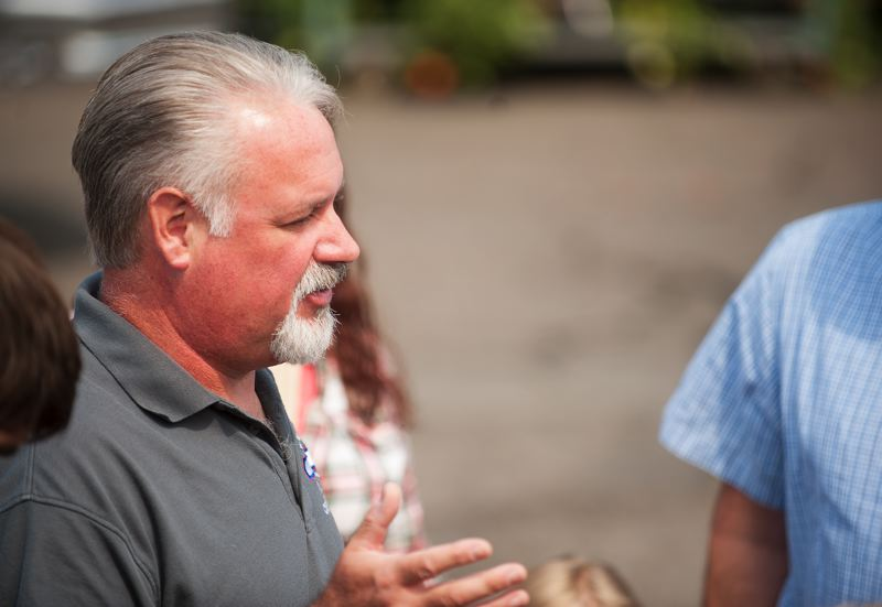 Photo Credit: SPOKESMAN PHOTO: JOSH KULLA - Jayson Scott, grandson of The Bomber founder Art Lacey, speaks with reporters Aug. 13 outside The Bomber restaurant.