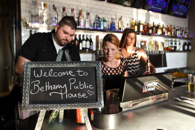 Photo Credit: TIMES PHOTO: JAIME VALDEZ - Employees at the Bethany Public House prepare drinks during the restaurant's soft opening.