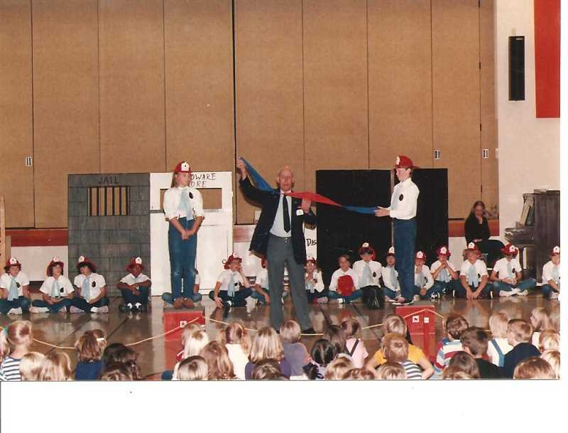Photo Credit: COURTESY OF DONALD ANDERSON - Donald Anderson performs a portion of Fireman Don's El Cheapo Magic Act along with the Fire Prevention Singers at Tualatin Elementary School back in the 1970s.