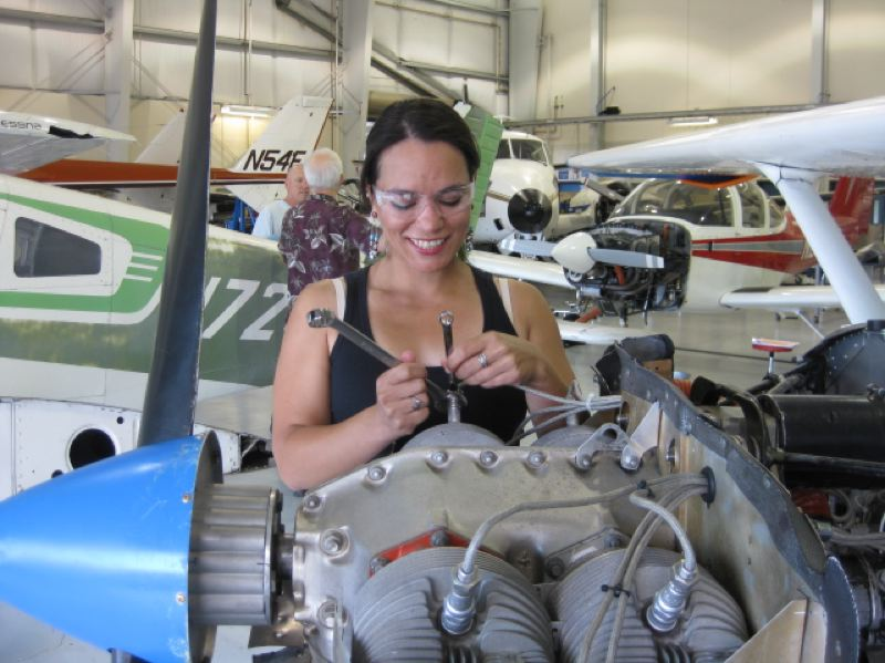 Photo Credit: COURTESY PHOTO  - April Long, a Scappoose resident, works on an aircraft component as part of Portland Community College's aviation maintenance program. Long will complete her Associate of Applied Sciences degree this December.