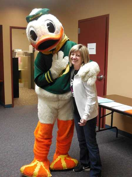 Photo Credit: COURTESY OF JENEVA ROSE - SHS counselor Jeneva Rose's family is all Ducks all the time, and even better than her office being a shrine to the University of Oregon was a personal visit from Puddles, the U of O mascot.