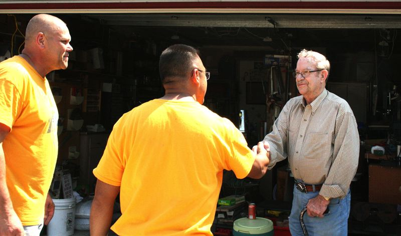 Photo Credit: CONTRIBUTED PHOTO: RICH ALLEN - Jack shakes hands with Navy Seabees at the end of a long day of work.