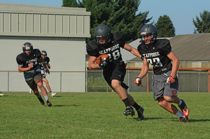 Photo Credit: JOHN WILLIAM HOWARD - Colton Bird's interception and run near the end of practice provided a highlight for the Indians, who will look to retool and fill the holes left by last year's standouts.