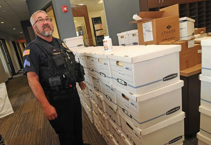 Photo Credit: TIDINGS PHOTO: VERN UYETAKE - West Linn Police Sergeant Dave Kempas stands next to file boxes recently moved into the new police station. At the old station, there were concerns that heavy files would cause the floor to collapse.