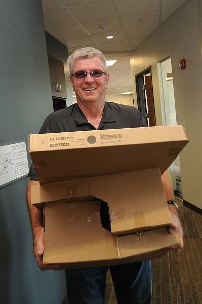 Photo Credit: TIDINGS PHOTO: VERN UYETAKE - Sergeant Neil Hennelly stayed in plain clothes while moving into his new office.