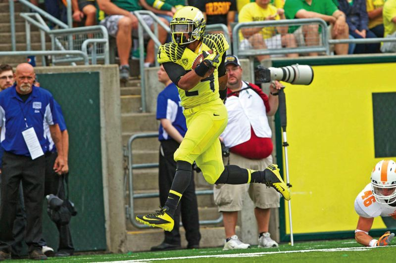Photo Credit: TRIBUNE FILE PHOTO - Running back Thomas Tyner and the Oregon Ducks are trying to supplant talented Stanford as the Pac-12 North football champion in 2014.