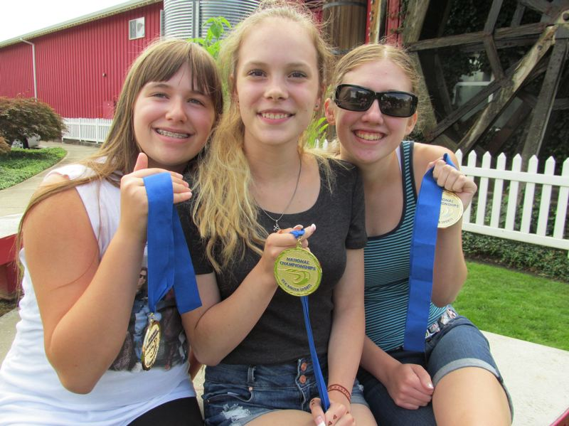 Photo Credit: PHOTO BY ELLEN SPITALERI - Displaying their first-place medals are, left to right, Caitlin Richardson, Adelaide Holenstein and Courtney Richardson.