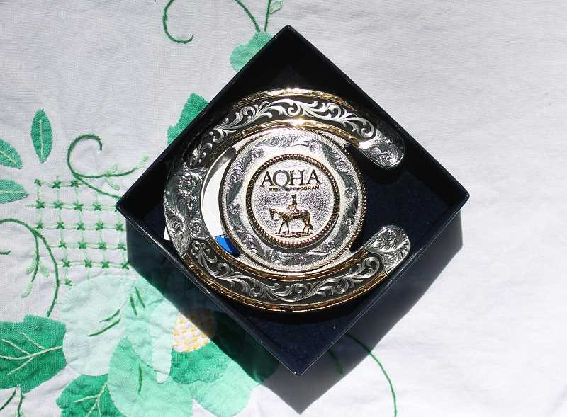 Judi Gobet of Oregon City had her name drawn in the raffle for this AQHA buckle, commeorating this year's Coleman Ranch Ride.