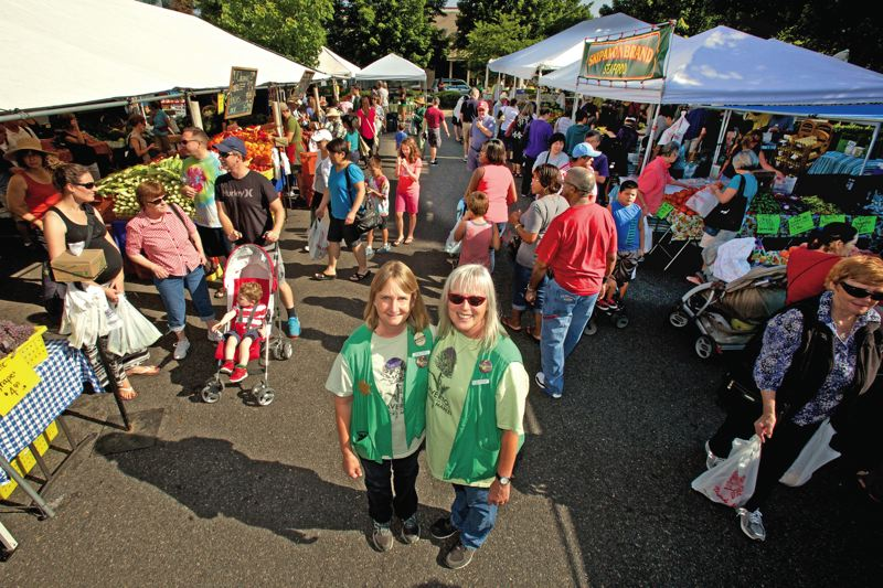 Photo Credit: TIMES PHOTO: JAIME VALDEZ - Together, Sue Poff and Ginger Rapport have stood at the helm of the Beaverton Farmers Market for the last 19 years. Both say that without each other, they wouldn't have been about to do it.