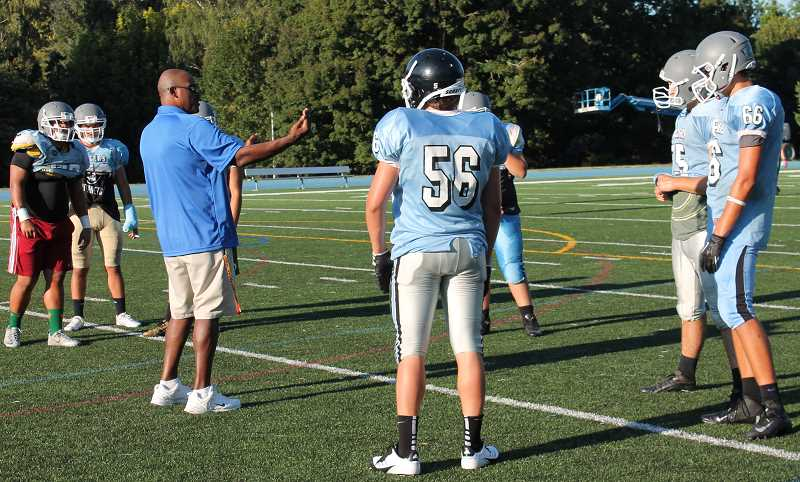 Photo Credit: REVIEW PHOTO: JILLIAN DALEY - Tim Price, Lakeridge High football defensive line coach, offers feedback to players during practice Tuesday evening.