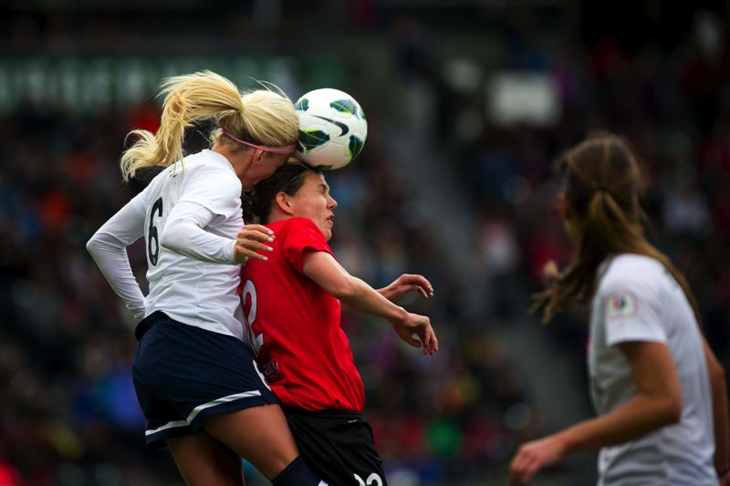 Photo Credit: TRIBUNE FILE PHOTO - Women soccer players such as the Portland Thorns Christine Sinclair (here in a 2013 match) are more prone to concussions than male soccer players.