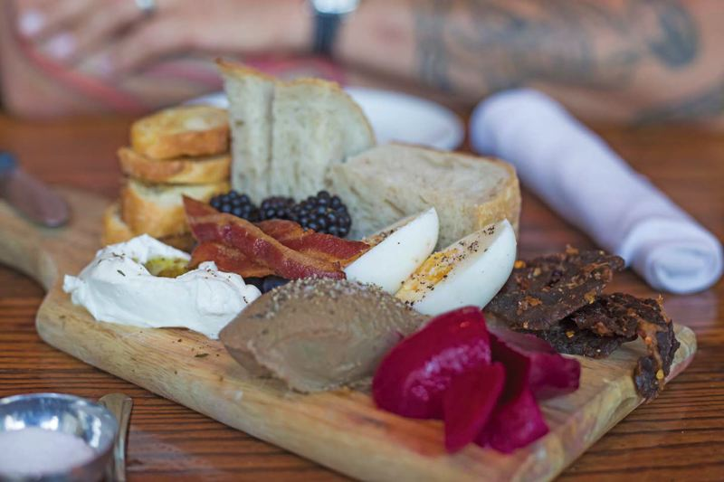Photo Credit: TRIBUNE PHOTO: JONATHAN HOUSE - It's the colorful Breakfast Plate at Tasty 'n Sons.