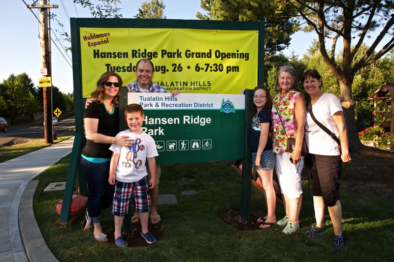 Photo Credit: TIMES PHOTO: JAIME VALDEZ - Wendy and Mark Gibson and their children, Ben, 8, and Emma, 11, pose for a picture with Colleen Lane and her daughter-in-law Kathy Fulton before the grand opening of THPRD's Hansen Ridge Park. The Gibsons bought the farmhouse once owned by Lane's grandparents, Harry and Ida Hansen.
