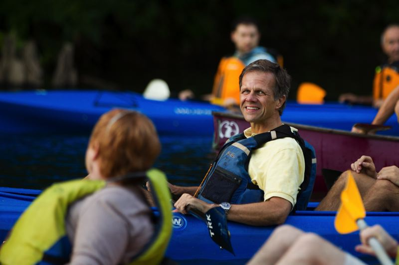 Photo Credit: TIMES PHOTO: DAVID BLAIR - State Sen. Mark Hass (D-Beaverton) flashes a smile during the Tualatin River Political Paddle Race.