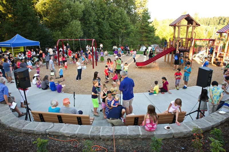 Photo Credit: TIMES PHOTO: JAIME VALDEZ - Families, area residents and special guests gathered in Bethany on Tuesday evening for the grand opening of THPRD's Hansen Ridge Park on Northwest Kaiser Road.