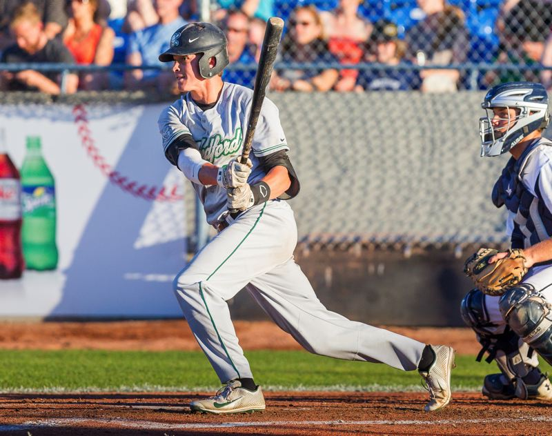 Photo Credit: CHRISTIAN J. STEWART/INDEPENDENT SPORTS NEWS - NO STOPPING HIM -- Tigard grad Spencer Smith had a big summer for the Medford Rogues, hitting for a .288 average with a team-high total of 36 runs scored.