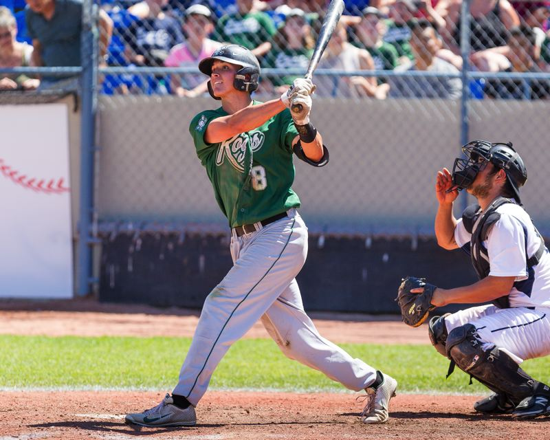 Photo Credit: CHRISTIAN J. STEWART/INDEPENDENT SPORTS NEWS - SMITH SMASH -- Spencer Smith, a 2011 Tigard High School graduate, takes a swing while playing for the Medford Rogues this summer. Smith, who played at Lane Community College this past spring, has signed to play at the University of Oregon.