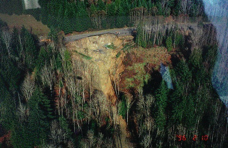 Photo Credit: COURTESY OF THE OREGON DEPARTMENT OF TRANSPORTATION - The aftermath of a landslide that collapsed a stretch of Highway 30 east of Clatskanie in 1996. The Oregon Department of Transportation referred to the ruination as 'complete roadway failure' and said it took 21 days to fully restore service. This particular slide was blamed on heavy rain, but earthquakes can cause landslides and rockfalls as well.