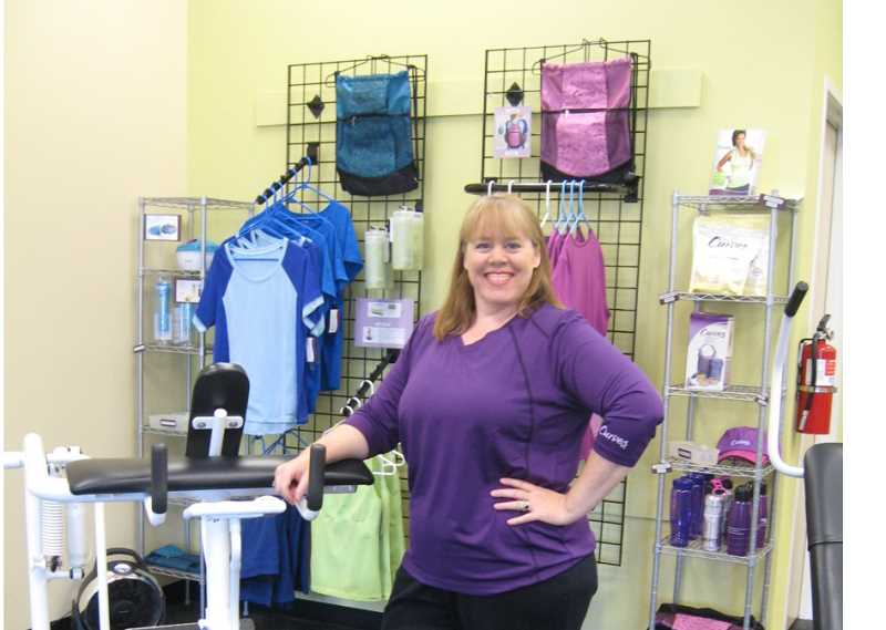 Photo Credit: SANDY HOLLAND - PRACTICES WHAT SHE PREACHES -Jennifer Kitchell goes from member to owner of Curves and moves it to the King City Plaza.
