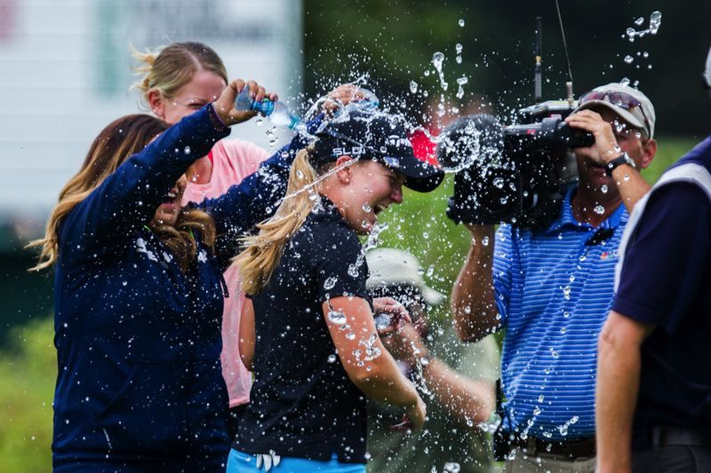 Photo Credit: COURTESY OF DAVID BLAIR - Fellow LPGA Tour players douse Portland Classic winner Austin Ernst with water moments after her winning par on the 18th hole - the first hole of a playoff - Sunday at Columbia Edgewater Country Club.