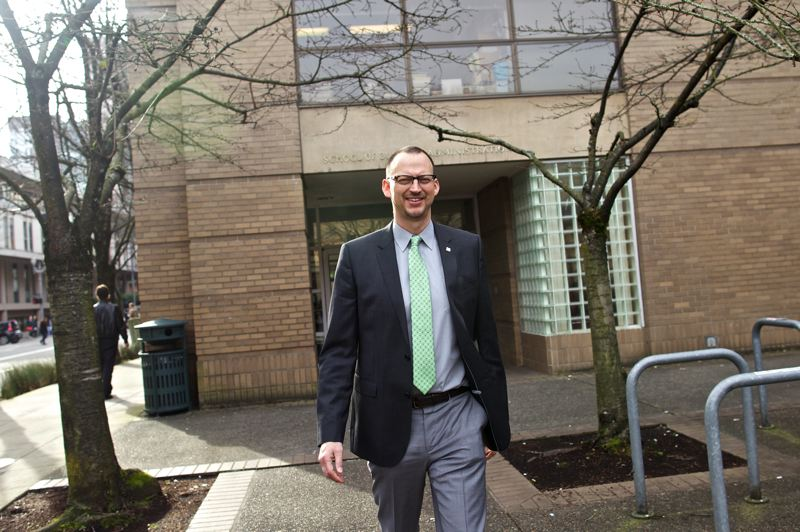 Photo Credit: TRIBUNE PHOTO: JAIME VALDEZ - Scott Marshall, who is the interim director for the Portland State University School of Business Administration, walks outside of the business school building.