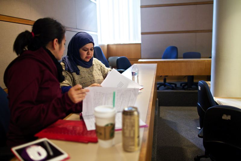 Photo Credit: TRIBUNE PHOTO: JAIME VALDEZ - Juanita Bibian and Hanan Buathab, both students at Portland State University, study for a class at the University School of Business Administrations building.