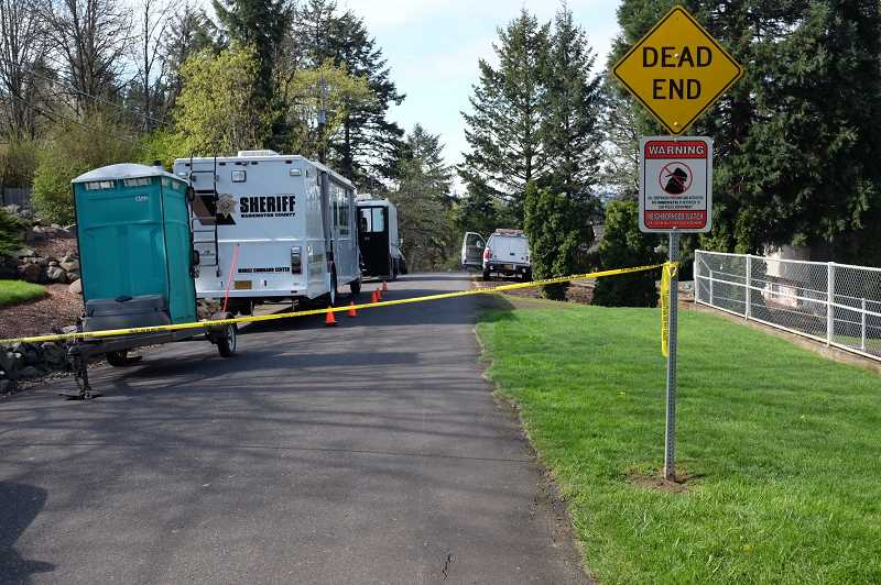 TIMES PHOTO: JAIME VALDEZ - Tigard Police and the Washington County Major Crimes Team are investigating after a 73-year-old man was found dead in a Metzger home, early Friday morning.